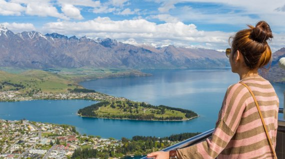 Young adult woman enjoy a stunning view of Queenstown