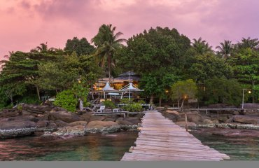 Wooden pier to a tropical island resort on Koh Kood island durin
